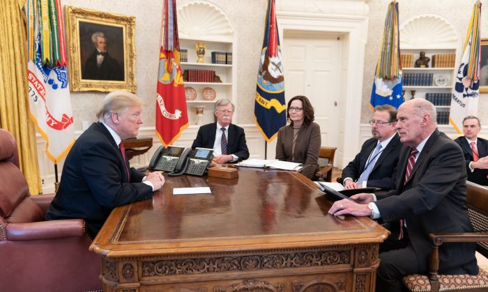 President Donald Trump (L) with heads of intelligence agencies, including Director of National Intelligence Dan Coats (R) and CIA Director Gina Haspel (3rd L) in the Oval Office in the White House on Jan. 31, 2019. (White House photo)