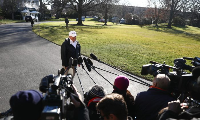 President Donald Trump speaks to media before departing the White House en route to the U.S.-Mexico border in McAllen, Texas, on Jan. 10, 2019. (Holly Kellum/NTD)