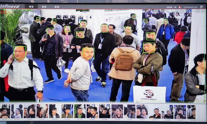 A screen shows visitors being filmed by AI security cameras with facial recognition technology at the 14th China International Exhibition on Public Safety and Security at the China International Exhibition Center in Beijing on Oct. 24, 2018. (Nicolas Asfouri/AFP/Getty Images)