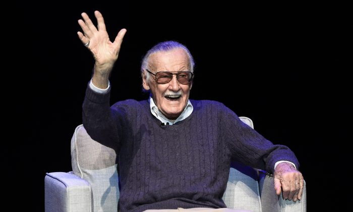 "Comic book writer Stan Lee waves to the audience after being introduced onstage at the ""Extraordinary: Stan Lee"" tribute event at the Saban Theatre in Beverly Hills, Calif., on Aug. 22, 2017. (Chris Pizzello/Invision/AP)"