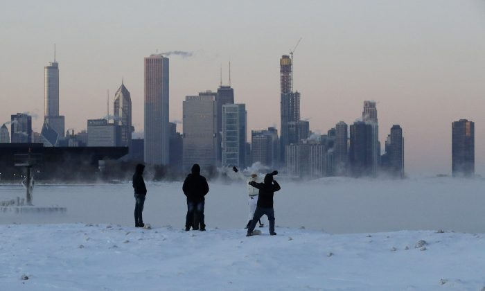 People enjoy at the Lake Michigan at 31st Street Harbor in Chicago, on Jan. 30, 2019. (Nam Y. Huh/AP)