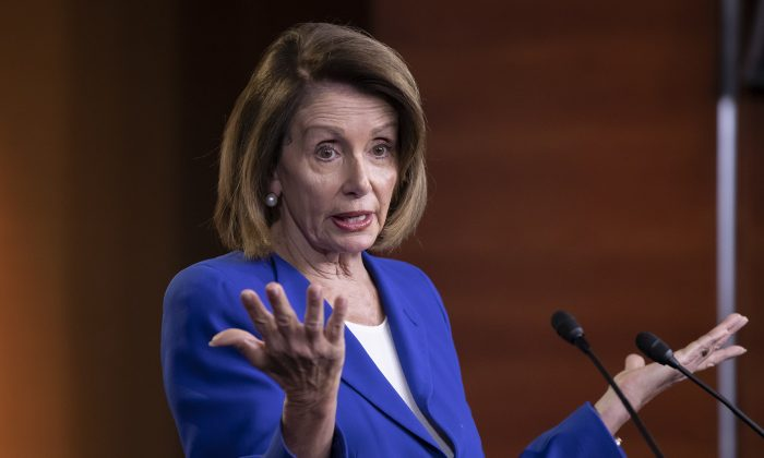 Speaker of the House Nancy Pelosi (D-Calif.) talks to reporters during a news conference a day after a bipartisan group of House and Senate bargainers met to craft a border security compromise aimed at avoiding another government shutdown, at the Capitol in Washington on Jan. 31, 2019. (J. Scott Applewhite/AP Photo)