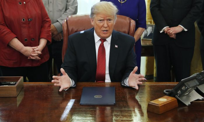President Donald Trump speaks during a meeting with American manufacturers in the Oval Office of the White House in Washington on Jan. 31, 2019. (AP Photo/Jacquelyn Martin)