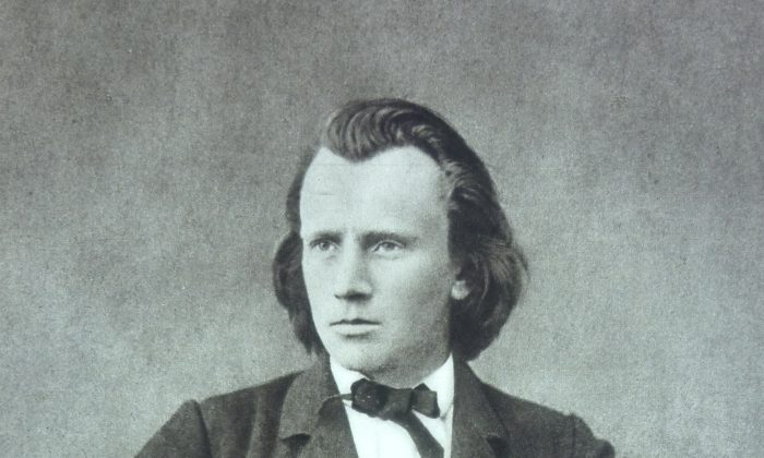 A photograph of Johannes Brahms in 1866 by Lucien Mazenod. (Public Domain)