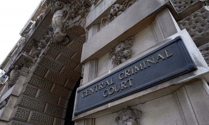 A sign is pictured at the main entrance of the Central Criminal Court, commonly referred to as the Old Bailey in central London on Aug. 21, 2016. (Niklas Halle'n/AFP/Getty Images)