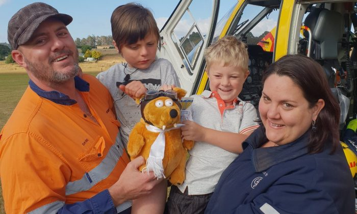 Robert Wright (centre R) with his family after the Tasmania State Emergency Service rescued him at Denison Gorge, Australia, on Feb. 1, 2019. (Courtesy of Tasmania Police)