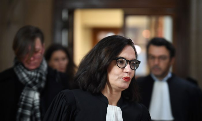 Sophie Obadia (C), the lawyer of Canadian Emily Spanton (back L), arrives at the Criminal Court in Paris on Jan. 14, 2019. (Eric Feferberg/AFP/Getty Images)