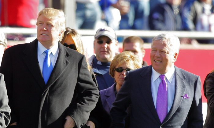 Donald Trump and owner of the New England Patriots Robert Kraft stand on the sidelines before the AFC Wild Card Playoff Game against the New York Jets at Gillette Stadium in Foxboro, Massachusetts on Jan. 7, 2007. (Photo by Jim McIsaac/Getty Images)