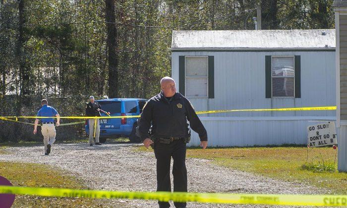 Investigators work the scene of a shooting in Livingston Parish in Louisiana. (Travis Spradling/The Advocate via AP)