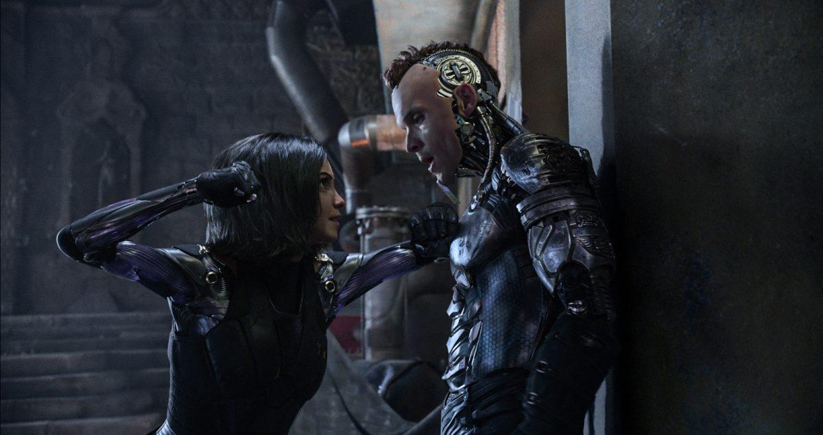 Female cyborg bounty hunter braces male cyborg