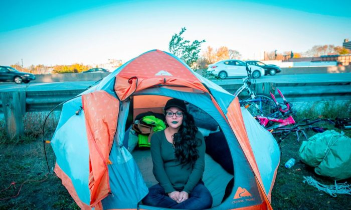 A young woman in her tent on Oct. 22, 2018. She is among the more than 200 people who live at the large encampment along Hiawatha and Cedar Avenues in Minneapolis, Minnesota. (KEREM YUCEL/AFP/Getty Images)