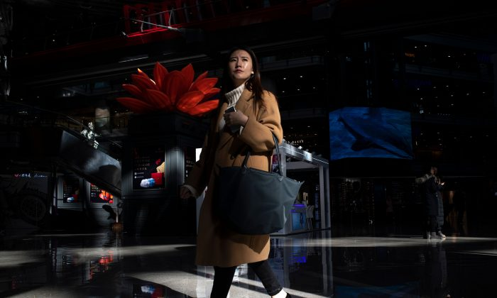 Customers walk in a Beijing shopping mall on Jan. 21, 2019. (Fred Dufour/AFP/Getty Images)