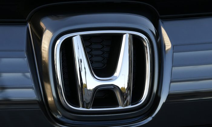 In this Jan. 11, 2016, file photo, the logo of Honda Motor Co. is seen on a Honda vehicle at the Japanese automaker's headquarters in Tokyo.  (Shuji Kajiyama/AP)