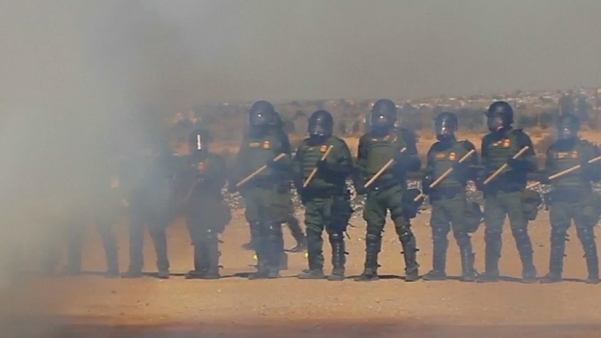 Officers in smoke tear gas