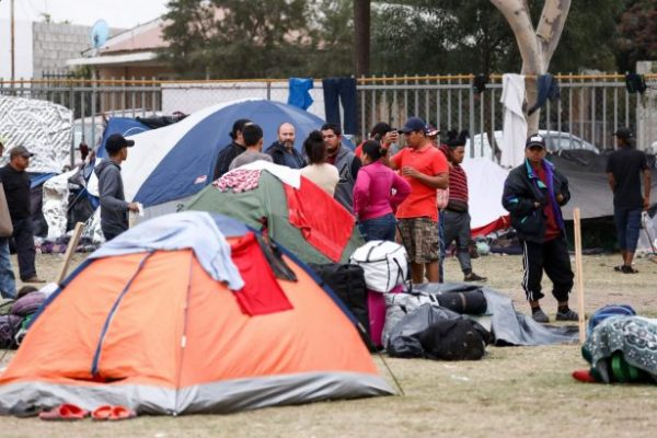 Members of the Central American migrant caravan camp out