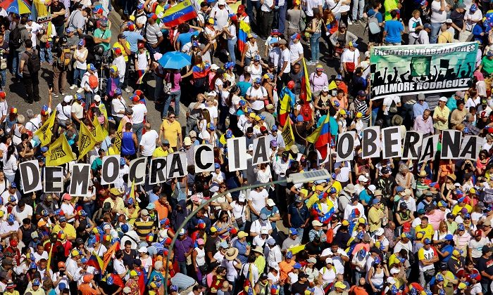 Opposition supporters take part in a rally against Venezuelan President Nicolas Maduro's government in Caracas, Venezuela ,on February 2, 2019. (Adriana Loureiro/REUTERS)