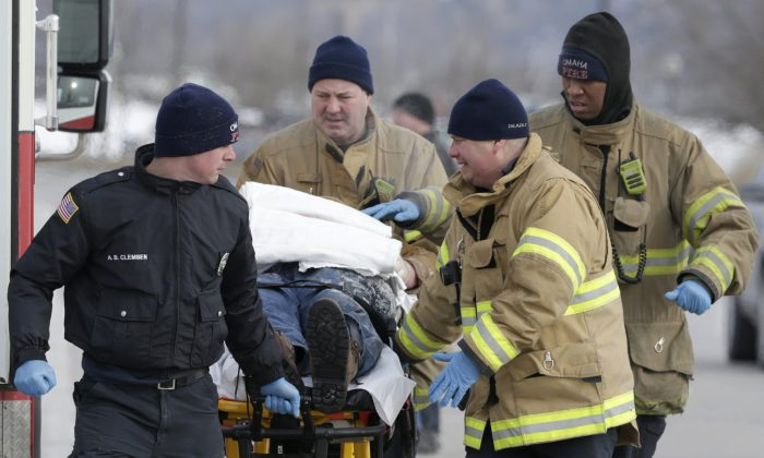 First responders evacuate a person found in sub-freezing temperatures on the banks of Carter Lake, in Omaha, Neb., on Jan. 30, 2019. (Nati Harnik/AP)