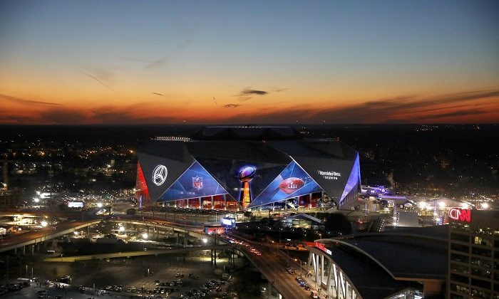 The sun sets behind Mercedes-Benz Stadium ahead of Sunday's NFL Super Bowl 53 football game between the Los Angeles Rams and New England Patriots in Atlanta, on Jan. 30, 2019. (David Goldman/AP Photo)