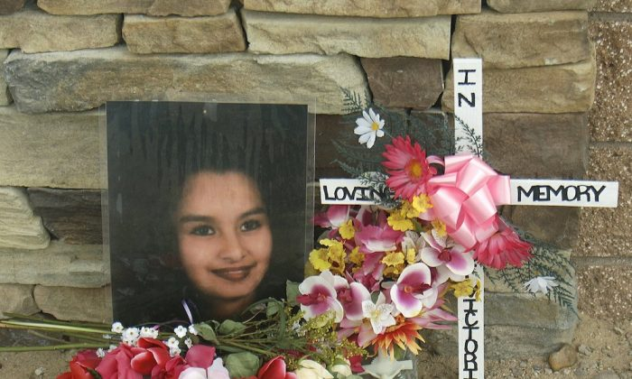 Memorial for Victoria Chavez near the Southwest Mesa area where bodies have been discovered on the west side of Albuquerque, N.M., on Feb. 23, 2009. (Adolphe Pierre-Louis/Albuquerque Journal via AP)
