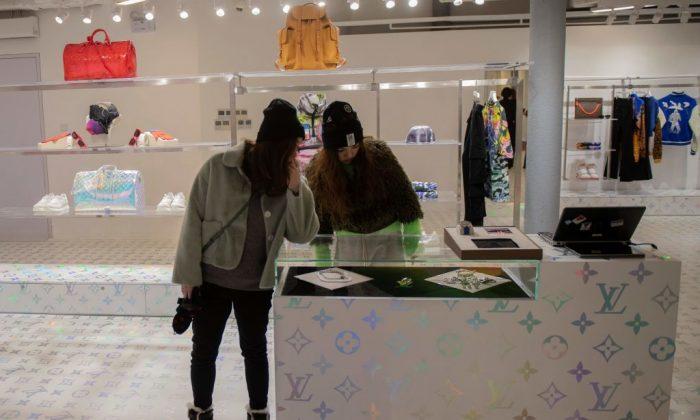Customers shop inside a luxury shop in Beijing on Jan. 21, 2019. (Nicolas Asfouri/AFP/Getty Images)