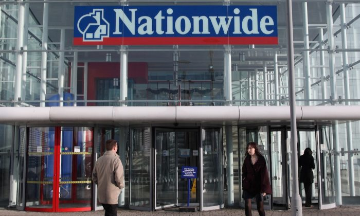 People walk into the main entrance of the Nationwide Building Society HQ in Swindon, England, on Jan. 2, 2009. (Matt Cardy/Getty Images)
