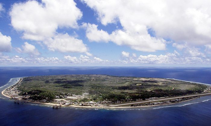 The island state of the Republic of Nauru awaits the arrival of 521 mainly Afghan refugees, 11 September 2001 which have been refused entry into Australia. (Torsten Blackwood/AFP/Getty Images)
