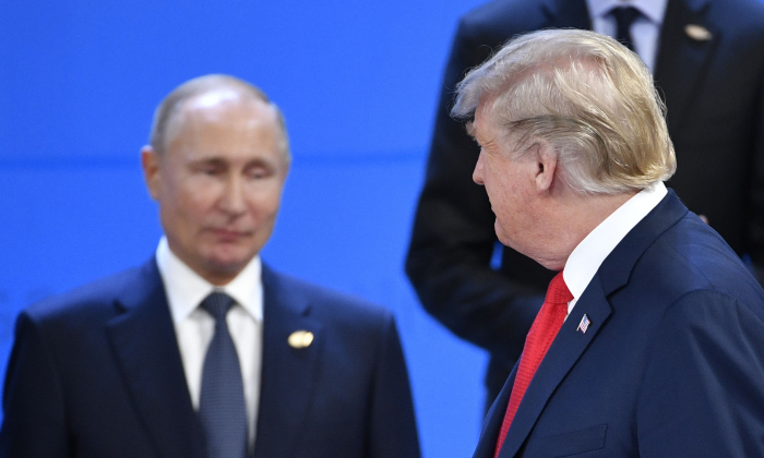US President Donald Trump (R) looks at Russia's President Vladimir Putin as they take their places for a family photo, during the G20 Leaders' Summit in Buenos Aires, on November 30, 2018. - Global leaders gather in the Argentine capital for a two-day G20 summit beginning on Friday likely to be dominated by simmering international tensions over trade. (Photo by Alexander NEMENOV / AFP)        (Photo credit should read ALEXANDER NEMENOV/AFP/Getty Images)