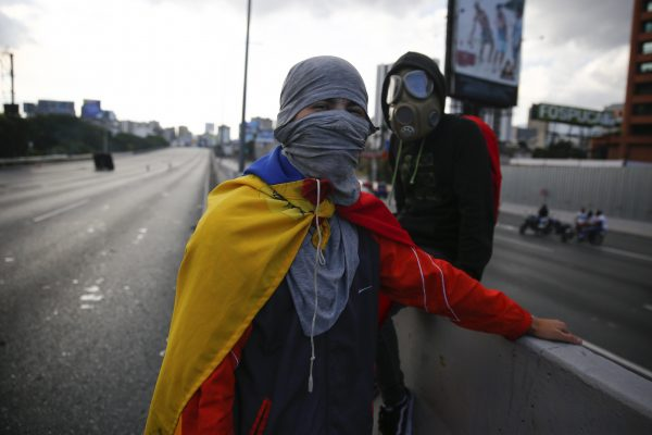 Demonstrators protest against the government of Nicolás Maduro in the main highway of Caracas on Feb. 2, 2019 in Caracas, Venezuela. (Marco Bello/Getty Images)