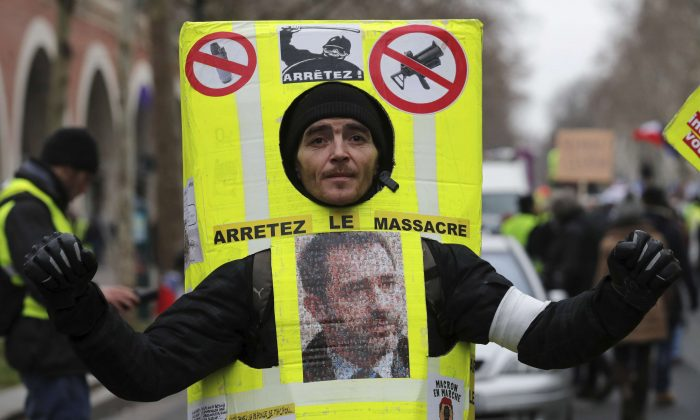 """French """"yellow vests"""" march through Paris on Feb. 2, 2019. (Philippe Wojazer/Reuters)"""