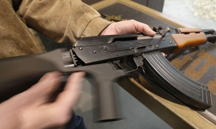 A bump stock is installed on an AK-47 and its movement is demonstrated at Good Guys Gun and Range in Orem, Utah, on Feb. 21, 2018. The weapon used in the drive-by shooting death of Kamren Jones is believed to be a semi-automatic rifle. (George Frey/Getty Images)