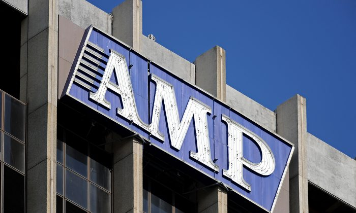 The corporate logo adorns the headquarters of the Australian fund-manager AMP in Sydney on Dec. 17, 2009. (Torsten Blackwood/AFP/Getty Images)