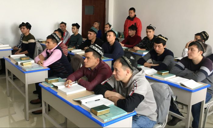 Islamic studies students attend a class at the Xinjiang Islamic Institute during a government organized trip in Urumqi, Xinjiang Uyghur Autonomous Region, China on Jan. 3, 2019. (Ben Blanchard/Reuters)