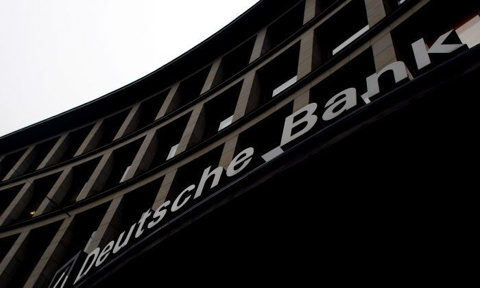 Light hits the logo of Deutsche Bank, Germany's biggest commercial bank, at a bank branch on January 14, 2009 in Hamburg, Germany. (Joern Pollex/Getty Images)