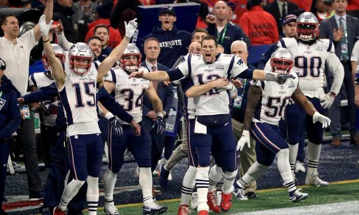The New England Patriots celebrate after winning the Super Bowl LIII against the Los Angeles Rams. (Photo by Mike Ehrmann/Getty Images)