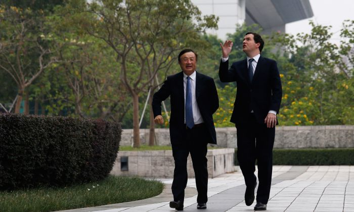 Huawei invites foreign officials to its headquarter as public relations methods. The photo was shot on on October 16, 2013 when British Chancellor George Osborne (L) visited Huawei headquarter and accompanied by Huawei CEO and founder Ren Zhengfei. (Bobby Yip - Pool/Getty Images)