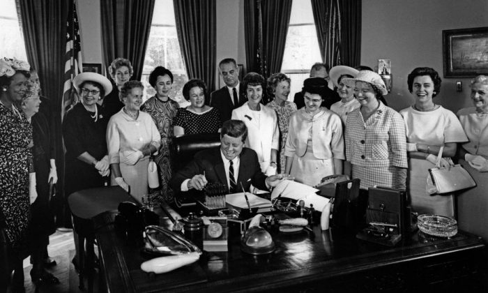 A SECTION_NYC A SECTION_NYC 100% 10  President John F. Kennedy signs the Equal Pay Act in the Oval Office of the White House on June 10, 1963.        JFK Presidential Library and Museum/Public Domain Screen reader support enabled.      		  President John F. Kennedy signs the Equal Pay Act in the Oval Office of the White House on June 10, 1963. JFK Presidential Library and Museum/Public Domain