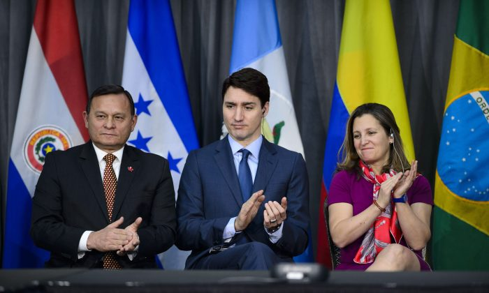 Peru's Minister of Foreign Affairs Nestor Francisco Popolizio Bardales (L), Prime Minister Justin Trudeau, and Minister of Foreign Affairs Chrystia Freeland at the opening session of the 10th ministerial meeting of theLimaGroupin Ottawa on Feb. 4, 2019. (The Canadian Press/Sean Kilpatrick)