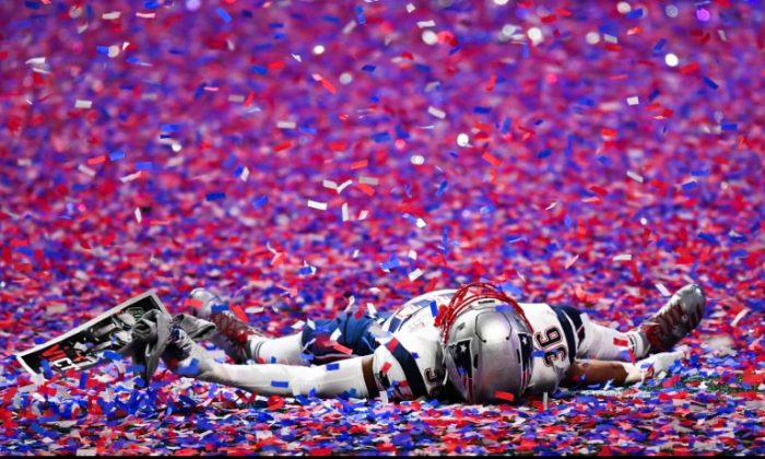 New England Patriots linebacker Brandon King (36) lays in the confetti after Super Bowl LIII against the Los Angeles Rams at Mercedes-Benz Stadium. (Dale Zanine-USA TODAY Sports)