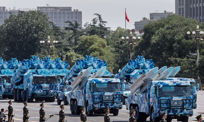 Chinese missiles are seen on trucks as they drive towards Tiananmen Square and the Forbidden City during a military parade in Beijing on Sept. 3, 2015. (Kevin Frayer/Getty Images)
