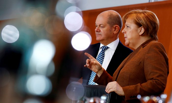 A file photo taken on Jan. 30, 2019, of German Chancellor Angela Merkel and Finance Minister Olaf Scholz in Berlin. (Fabrizio Bensch/Reuters)