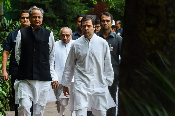 President of the Indian National Congress Party Rahul Gandhi (R) talks with Congress party's national general secretary Ashok Gehlot (L) and party memeber Motilal Vora (C) at the All India Congress Committee offices where Gandhi met the Congress Working Committee in New Delhi on Aug. 4, 2018. (Chandon Khanna/AFP/Getty Images)