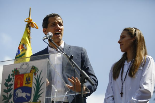 Opposition leader and self-proclaimed interim president of Venezuela Juan Guaidó and his wife Fabiana Rosales take part in a rally against the government of Nicolás Maduro in the streets of Caracas on Feb. 2, 2019 in Caracas, Venezuela. (Marco Bello/Getty Images)