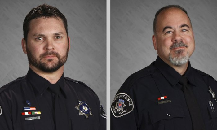 Two Colorado sheriff's deputies, O'Brien and Adam Lunn, have been charged with manslaughter in the death of a 23-year-old man that investigators found had been handcuffed and placed face down on the floor of a police van. (Boulder County Sheriff's Office via AP)