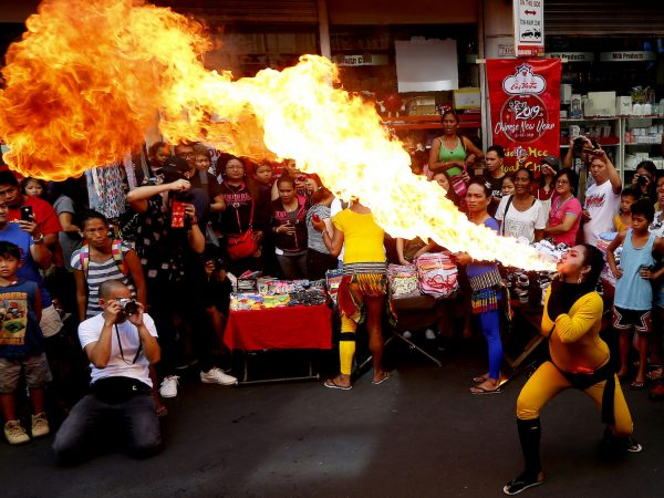 A fire-eater performs during celebrations