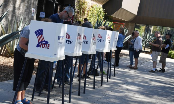 People vote at outdoor booths during early voting for the mid-term elections in Pasadena, Calif. on Nov. 3, 2018. (Mark Ralston/AFP/Getty Images)