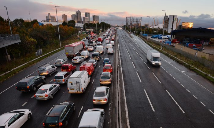 Traffic on a main route into London by the towers of the financial district Canary Wharf on Oct. 28, 2013. (Ben Stansall/AFP/Getty Images)