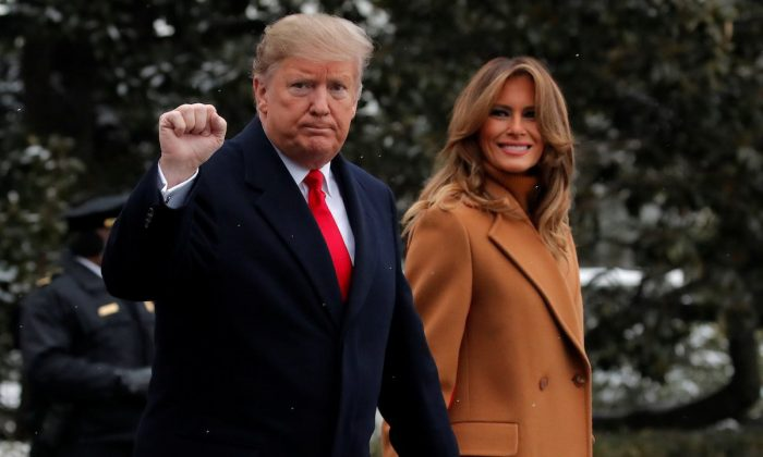 U.S. President Donald Trump walks with first lady Melania Trump while departing for Palm Beach, Florida from the White House in Washington, U.S., Feb.1, 2019. (Reuters/Jim Young)