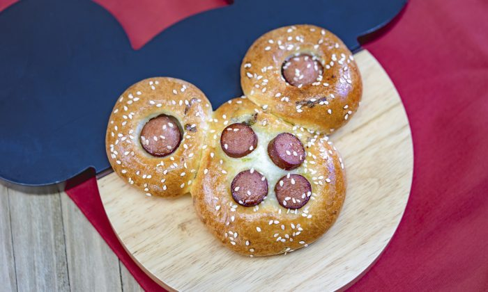 This undated photo provided by Disneyland Resort shows a Mickey Mouse-shaped Chinese hot dog bun from the Prosperity Bao & Buns marketplace at Disney California Adventure Park in Anaheim, Calif. (Disneyland Resort via AP)