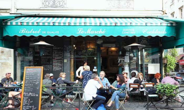 People from all walks of life gather at the city's bistros. (Shutterstock)