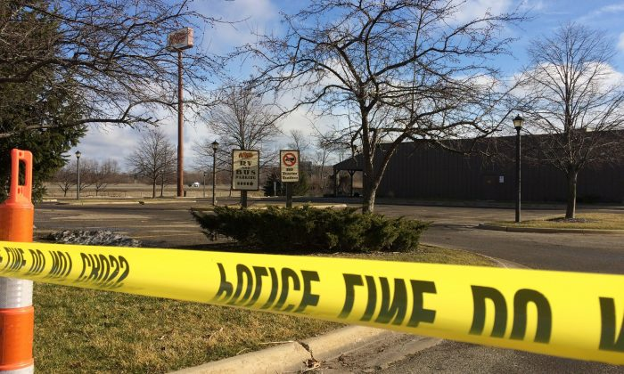 Police tape surrounds the area of a random shooting in Kalamazoo, Mich. in a file photo. (Jeff Karoub/File via AP)